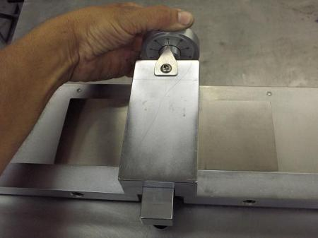 Setting the dial on the Tensilkut machine